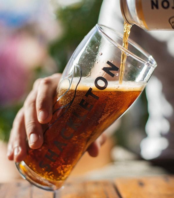 Shackleton beer glass being filled up with beer